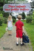 Deux enfants aux petites valises