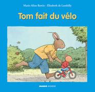 Tom fait du vélo